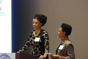2009 PEEP Scholarship recipient addresses the luncheon audience and presents PEEP with a check to 'give back' to the program that helped her secure a college degree. Pictured with PEEP founder Dee Dixon (r).